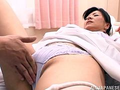 Japanese nurse gets her cooch fingered and banged doggy style