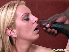 This blonde takes one cock in each hole at first, but then both this black dude and this white dude shove their big dick in her anus. That's when she moans the loudest.