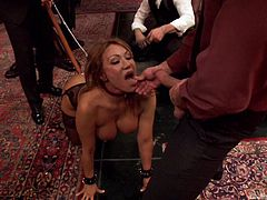 A busty brown-haired milf wearing stockings and high heels is humiliated by a man while others stay and watch all the kinky event. The perverse game involves playing dirty with a dildo. She is also wearing a collar at her neck while she is encouraged to suck dick. Click and see!