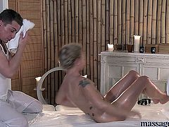 Two masseurs provide her with double the pleasure, with one pink headed cock squirting on her gash and the other purple headed dick filling her mouths with white seman.