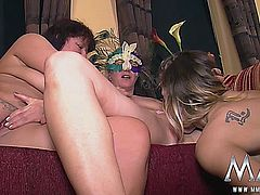 It´s her first time at the swingers club so the girls give her a warm welcome.