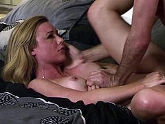 Blonde porn star with a nice ass getting her shaved pussy fingered in her bedroom
