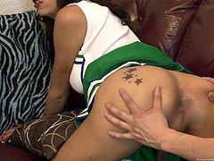 This big dicked tranny is looking sexy in her cheer uniform. she lets her Asian friend suck on her toes and do much more. He sucks her cock, too. She sticks her ass in her face so he can so how well he can give a rimjob.