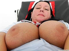 If you consider bitches wearing nurse uniforms very hot, click to meet a fatty bitch who gives in to her lusty desires right in a hospital room, laying on the patient's table and exposing her huge breasts and horny cunt in front of the camera. The slutty woman uses a dildo. Click to see!