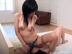 Two Japanese lesbians oil their bodies and scissor indoors