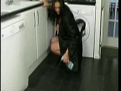 Watch this young busty housewife cleaning the kitchen. I great amateur clip for downblouse and big boob lovers