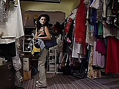 A woman finds great customer service at a small clothing shop.