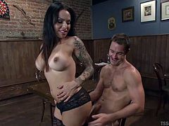 Are you into transsexual women with huge sexual appetite, that look hot and starving for a piece of cock? Foxxy is an attractive black-haired shemale, with tattoos on her arms. With sensual movements she undresses, showing off her big tits. The naked guy is mesmerized by her presence and begins sucking cock!