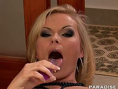 Gorgeous blonde Gina masturbates and fucks herself with a purple dildo.