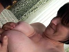 This old grandma is a fat fuck and she is super horny. She takes off her top, to reveal her massive natural breasts, that are chunky and super saggy. She sucks off her younger boyfriend and then, titfucks him.