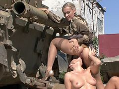 Two sexy military women have a lesbian hook up while in uniform