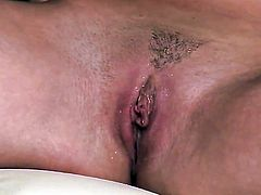 Donna Bell touches her bush gently