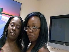 These two ebony ladies of the night get together to take care of one white cock as they take turns sucking it in this free tube video.