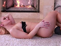 The beautiful and lovely Ash is making love with her boyfriend by the fireplace, on the floor. They are having hot and steamy sex. He rubs her boobs and he climbs on top of her. Look at her, how she gets her cunt licked.