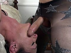 This beautiful and luxurious transexual has a stiff erection, bulging out of her alluring fishnet stockings. She rubs her dick, when her man comes along and licks, and scrubs her cock too. This guy is freaky and kinky, because he is wearing nylons and Penny likes it. The tranny licks his dick over his stockings.