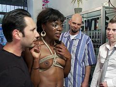 Do you like watching beautiful ladies, being disgraced in public? A brunette milf uses a vibrator, to stimulate the ebony bitch's horny pussy. Ana has been strongly bonded with rope. Everyone around watches her, being fucked up hard from behind, while she tries to unzip another guy's pants. Enjoy the show!