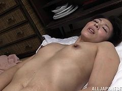 Watch as this sexy mature Japanese lady has lots of fun getting nasty. She kisses her man and then, he shoves his finger deep into her vagina. Soon she is dripping wet from her man fingering her, so he sticks his face in her crotch and gives her cunnilingus.
