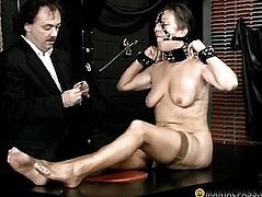 A woman in her mouth shoves his gag