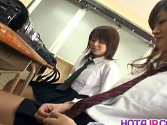 Watch these two sexy Japanese school babes getting troubled by some boys in the classroom.See how these horny boys makes them naked for toying there hairy cunts with vibrators.