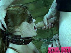 The master shoves his cock deep into her chained slaves throat, but she doesn't know what to expect, because she has an eye mask on her face. The chained slut chokes on his big meat and then moans loudly, as she take his penis from behind.
