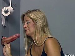 It seems like sucking stranger´s cocks in the bathroom is something that this horny blonde loves doing.