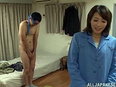 Inviting Asian dame caressing her husband passionately before giving him steamy handjob