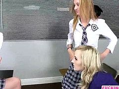 Cute students fucked with their teacher in the classroom
