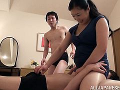 This sexy mature Japanese lady is looking sexy in her pantyhose, and she is going to have a nice threesome with her young friends. They undress and play with her big boobs, and now she is going to sit on one's face and suck off the other.