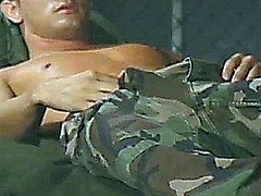 Muscle stud in uniform wakes up horny and gives a hand massage to his enormous stiff shaft until he finished on his feet