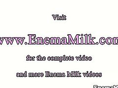 Milk enema lover squirting over her lesbian gf.