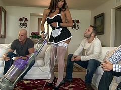 She is walking around the room dressed as a sexy French maid. As she cleans up the man try to get a look at her cock and ass. she really loves teases them. Finally, she lets them have a taste and whips out her big cock, so the blowjobs begin. One guy sucks her off, the other rims her and the third, sucks nipples.