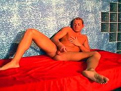 This gay hunk is horny and lays on his bed to masturbate in this free tube movie.