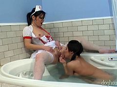 Sweet lesbian bitch in nurse suit seduces her torrid busty pal in bath