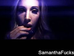 Samantha Saint wears clothes and uses a butt plug that glow in a black light. She shoves that thing in her ass and then in her mouth, teasing with her naughtiness.