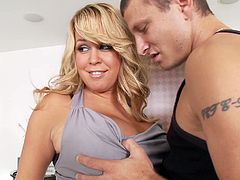 Bosomy blonde Brandy Talore gives head & gets fucked from behind