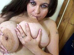 This nasty Euro skank is in the nude and ready to show off her mature body. She plays with her huge tits and even, bites her nipples. What a bad girl she is! Look, how she makes her gigantic breasts jump up and down.