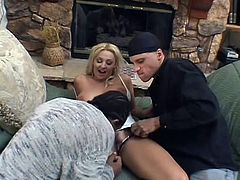 This blonde slut loves to take all kinds of cock in her holes. The black guy eats her pussy, while she sucks on a meaty black dick. They grab her boobs and it looks, like she wants a taste of black dick, too.