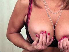 Rae has her tits out and she plays with them, for you. The sight of her amazing natural boobs is quite a spectacle. The dirty girl moves her hands down to, in between her thighs and she starts to rub her sexy, mature cunt.