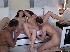 Fantastic foursome action along Russian babes giving blowjob and fucked
