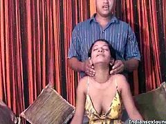 This Indian chick gets naked and lets this guy play with her breasts. He sucks on her nipples and then she strokes his cock while they are both bare naked.