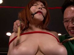 Anri Okita is an Asian sweetheart with massive natural boobs. She is bound lightly and stimulated before the guys start to penetrate her trimmed cunt and fuck it.