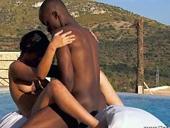 This lovely ebony girl gets penetrated slowly by her well-endowed black lover. They start on the bed and continue outside, by the pool. The rhythm doesn't change.