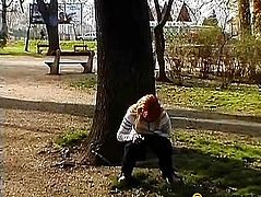 Woman writing in a tree in the park