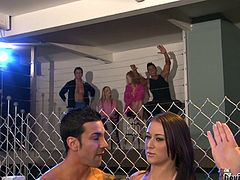 Alexis is sucking off the MMA champ in the cage and she is doing a great job of it. The blonde announcer is calling the shots and making the hot brunette suck that cock, until it cums. Will she make him explode?