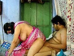 Horny Indian wife Savita in her normal outfit revealing her huge side boobs got it groped by her hubby and fucking her in reverse cowgirl in their bedroom.