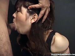 Watch this sexy brunette Japanese babe in this hot cock sucking video.See how this dude punishes her by tying her in ropes and fucking her mouth with his stiff cock till he creams her face.