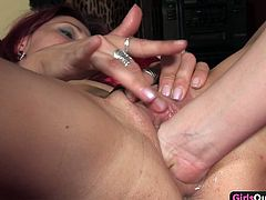 Two stunning MILFs are in bed together naked. They have their pussies bared and their hands oiled up. One by one they insert their fingers into each other's pussy and start fisting each other.