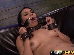 This dirty slut has cuff on her arms and a collar, around her neck so, that the mistress can take complete control of her. The slave's mouth is stretched open and her cunt spread wide, so she can take a big strap on. The mistresses finger and uses a vibrator, too.