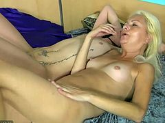 Young girl and pretty mature masturbating together on the bed
