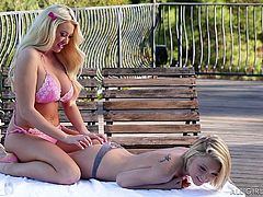 Courtney is out on the balcony with her young lesbian lover. She gives her a massage and rubs the young girl's cute ass. Will the sexy lesbians fuck each other and have nasty sex? Watch and see the hot action.